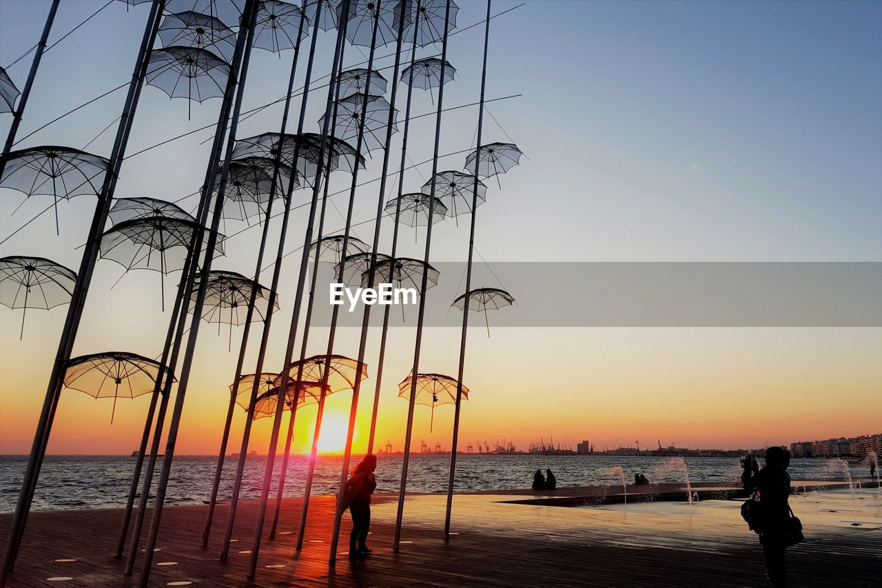 SILHOUETTE OF SAILBOATS ON BEACH