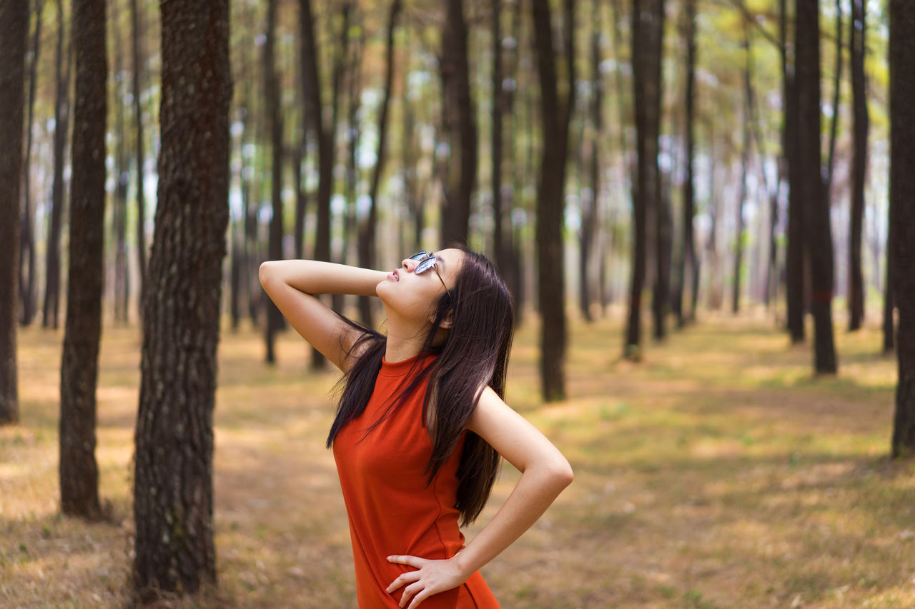 Portrait Of Woman Posing In Forest