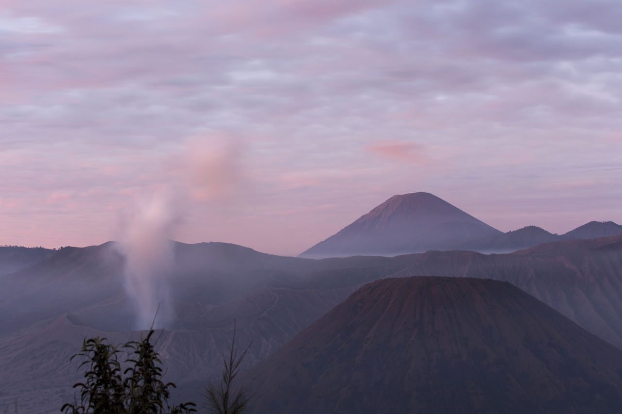 mountain, scenics - nature, beauty in nature, sky, volcano, tranquil scene, landscape, non-urban scene, tranquility, environment, cloud - sky, erupting, geology, no people, nature, land, smoke - physical structure, idyllic, physical geography, power in nature, outdoors, volcanic crater, mountain peak