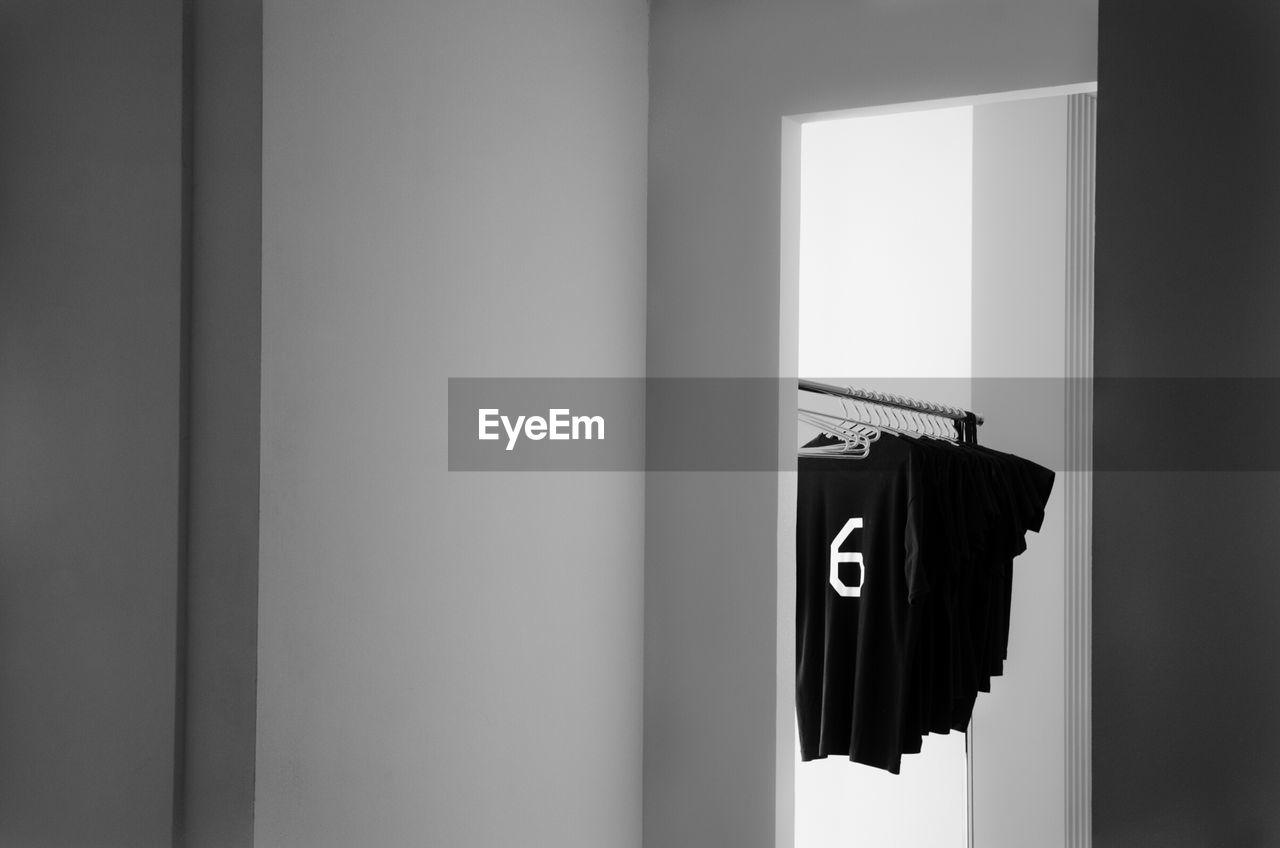 indoors, door, hanging, number, no people, day, coathanger, locker room, close-up, architecture