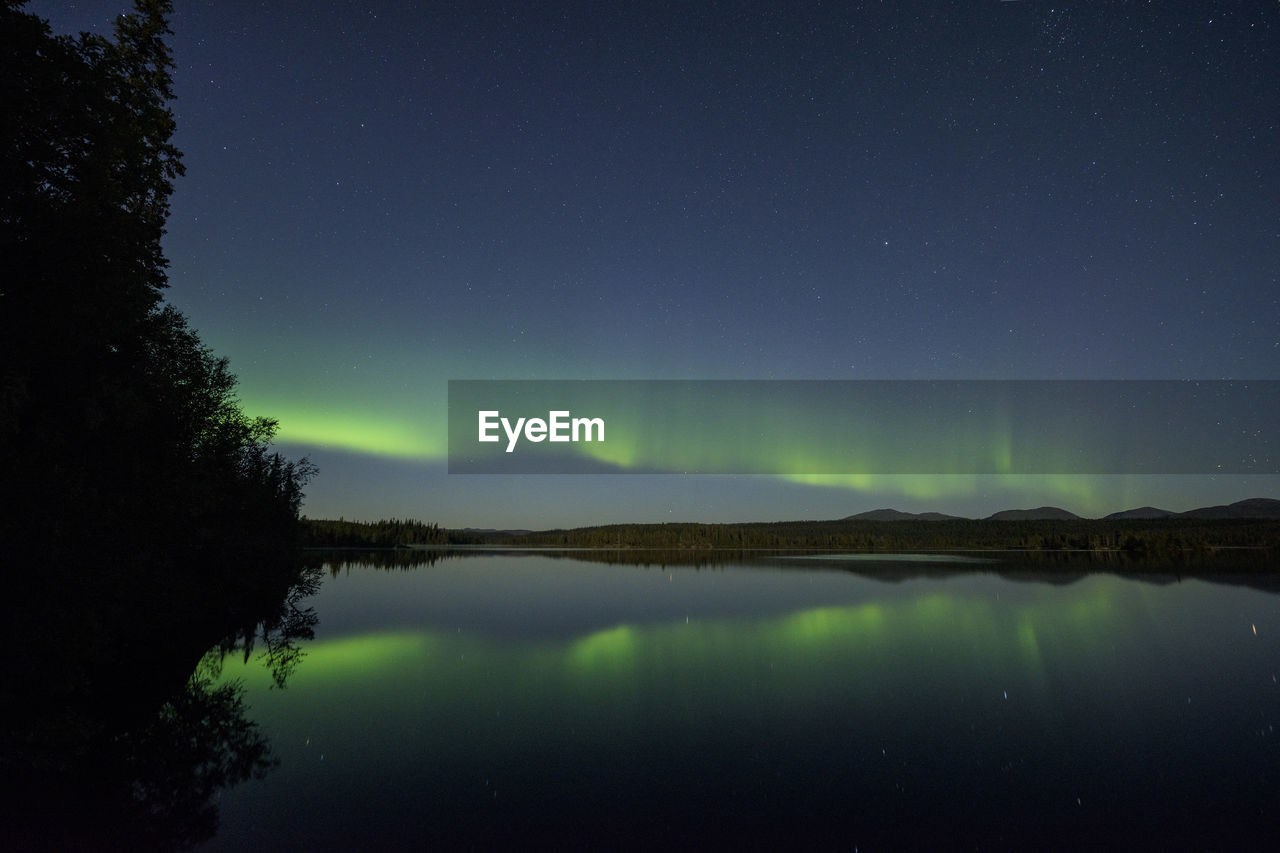 SCENIC VIEW OF LAKE AGAINST STAR FIELD IN SKY