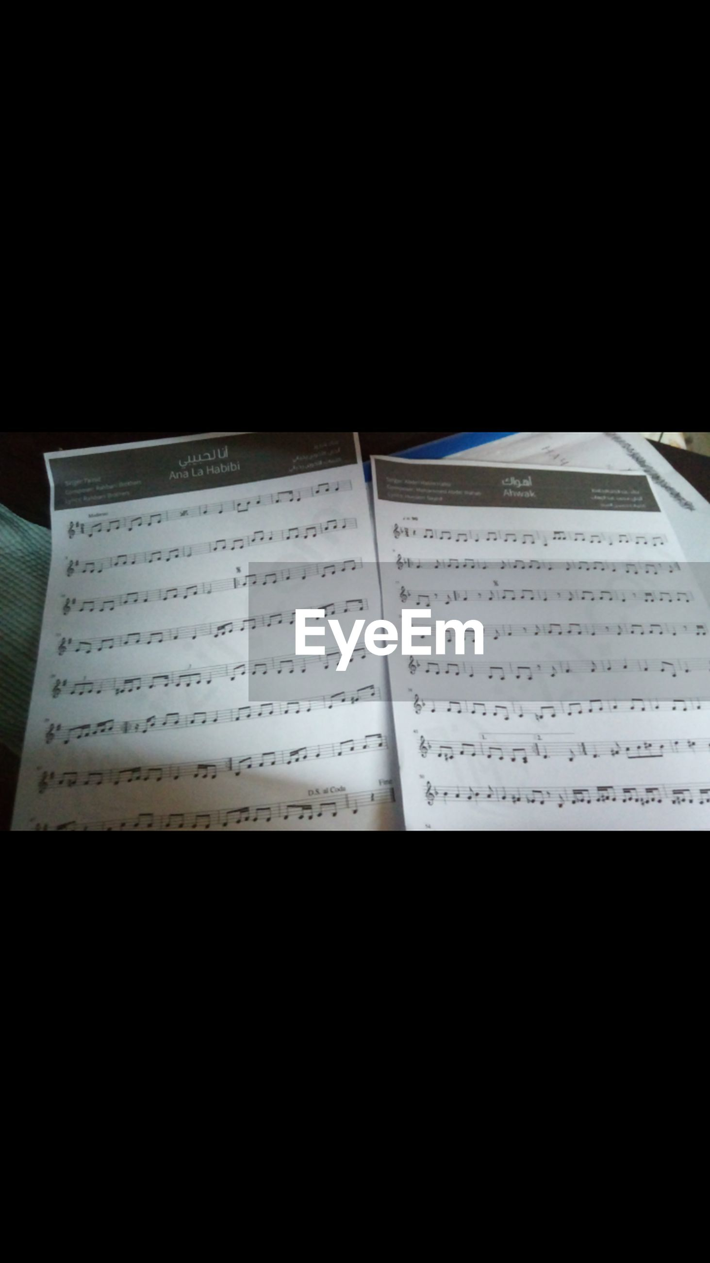 sheet music, close-up, no people, musical note, indoors, black background, classical music, day
