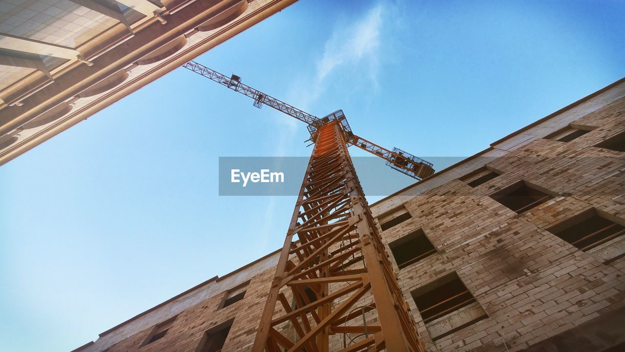 Industrial crane in construction site