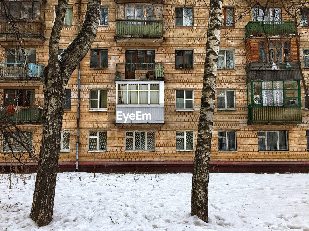snow, architecture, winter, building exterior, built structure, cold temperature, building, window, house, residential district, day, no people, nature, outdoors, travel destinations, tree, white color, city, wood - material, snowing, cottage