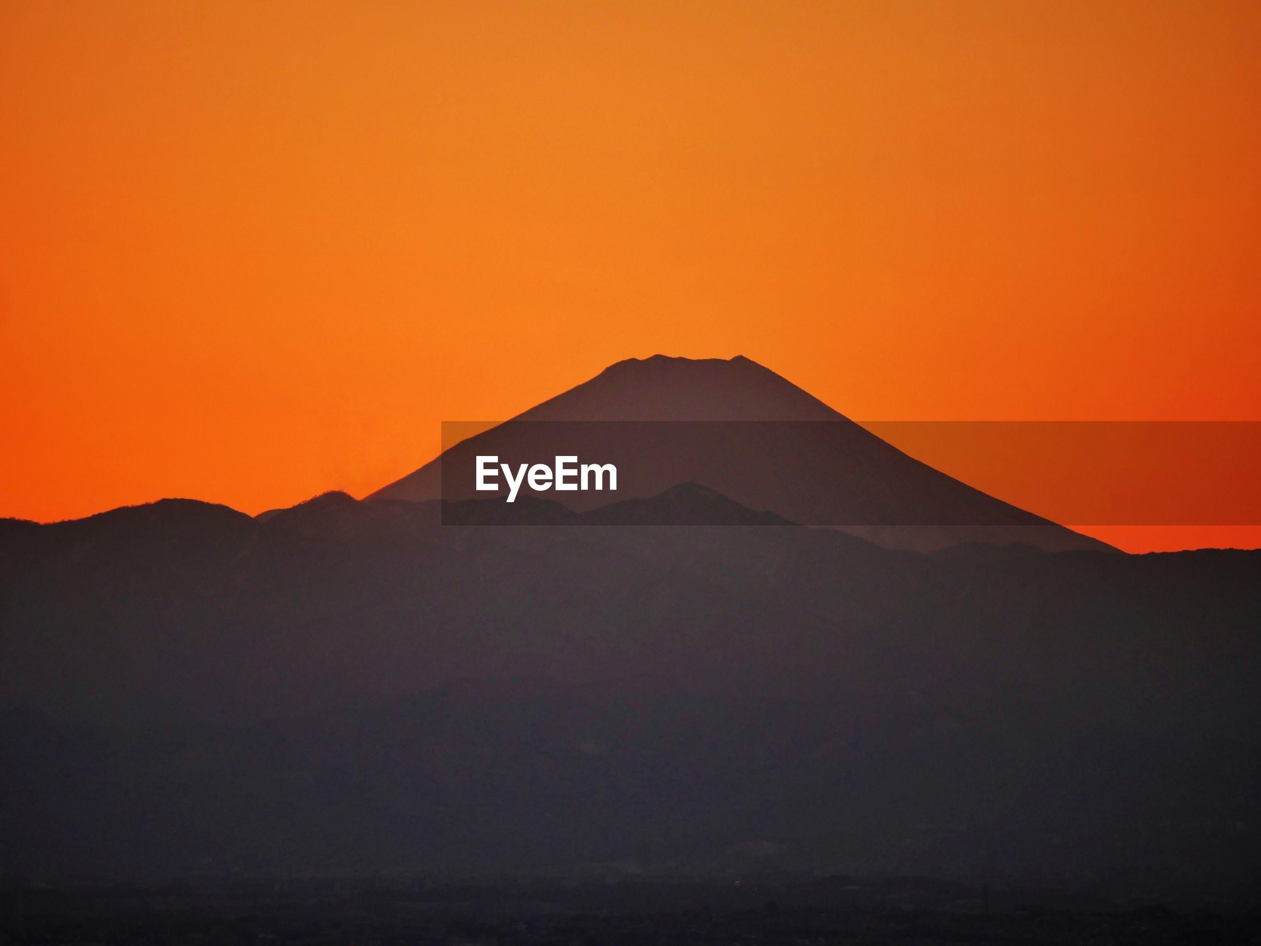 Scenic view of mt. fujii against orange sky