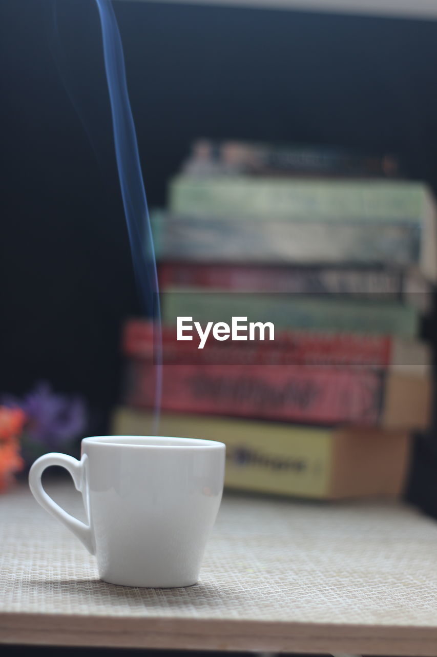 drink, cup, refreshment, still life, table, indoors, food and drink, mug, no people, coffee cup, close-up, coffee, coffee - drink, publication, focus on foreground, book, tea, hot drink, freshness, selective focus, tea cup, crockery, non-alcoholic beverage