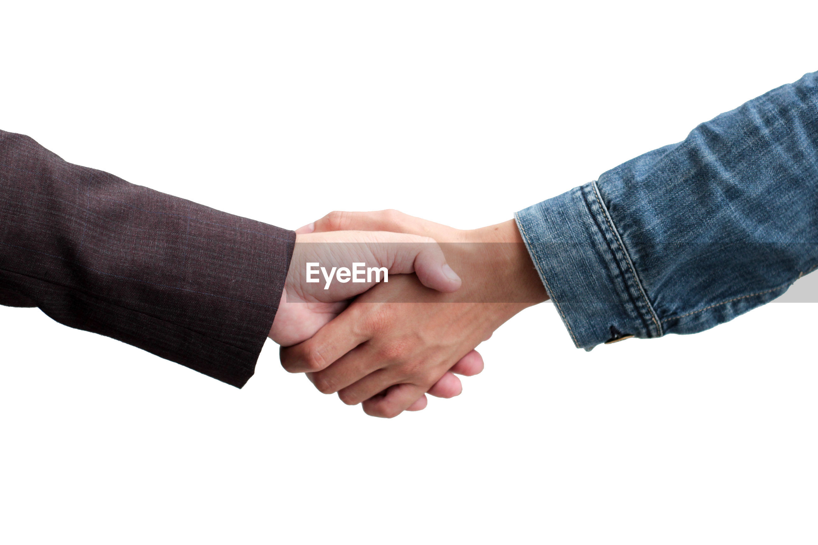 Cropped image of businessmen shaking hands over white background