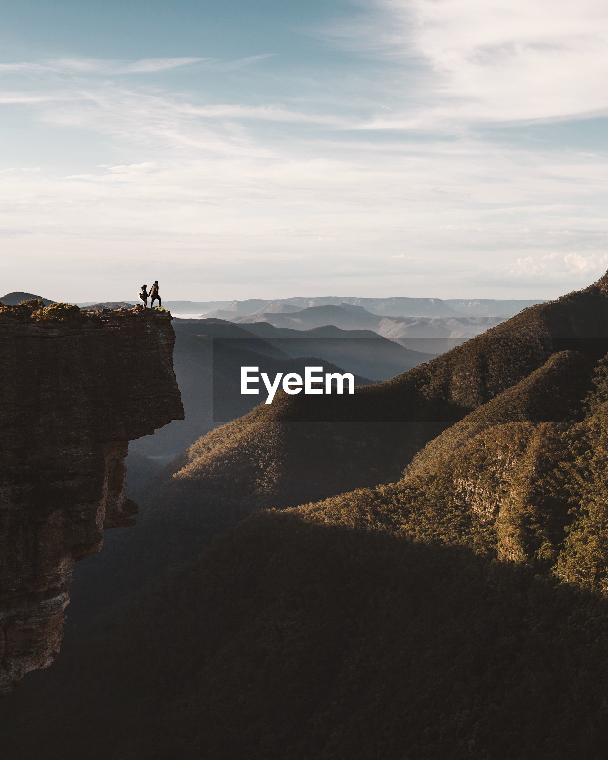 High angle view of persons on mountain against sky
