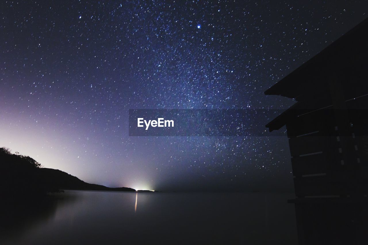 night, beauty in nature, scenics, nature, sky, tranquil scene, water, tranquility, star - space, no people, star field, outdoors, silhouette, astronomy, starry, galaxy, low angle view, clear sky, sea, mountain, constellation, star trail