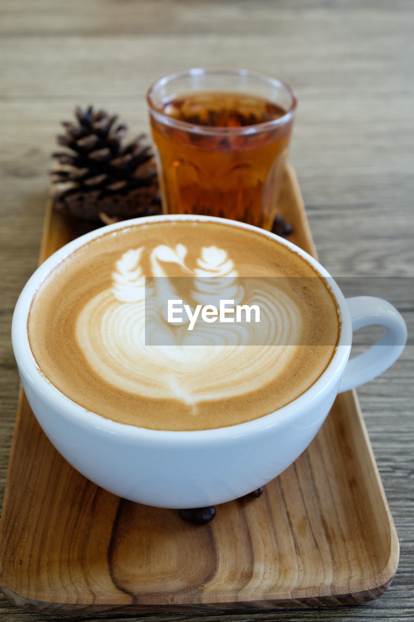 drink, refreshment, food and drink, coffee - drink, cup, coffee, mug, frothy drink, coffee cup, still life, hot drink, cappuccino, froth art, table, latte, freshness, wood - material, creativity, food, saucer, crockery, no people, non-alcoholic beverage, froth
