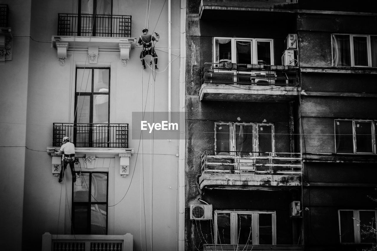 building exterior, architecture, built structure, building, window, residential district, day, city, no people, outdoors, pipe - tube, connection, wall, balcony, occupation, nature, low angle view, apartment