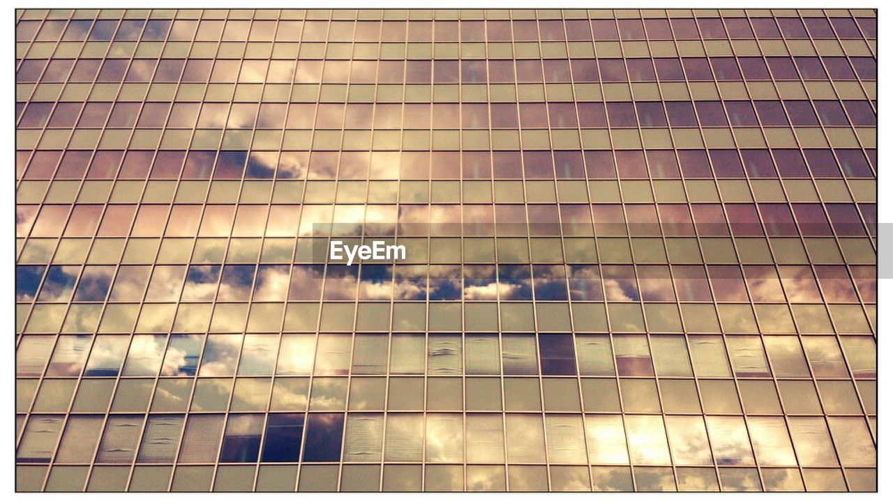 Reflection Of Cloudy Sky On Building