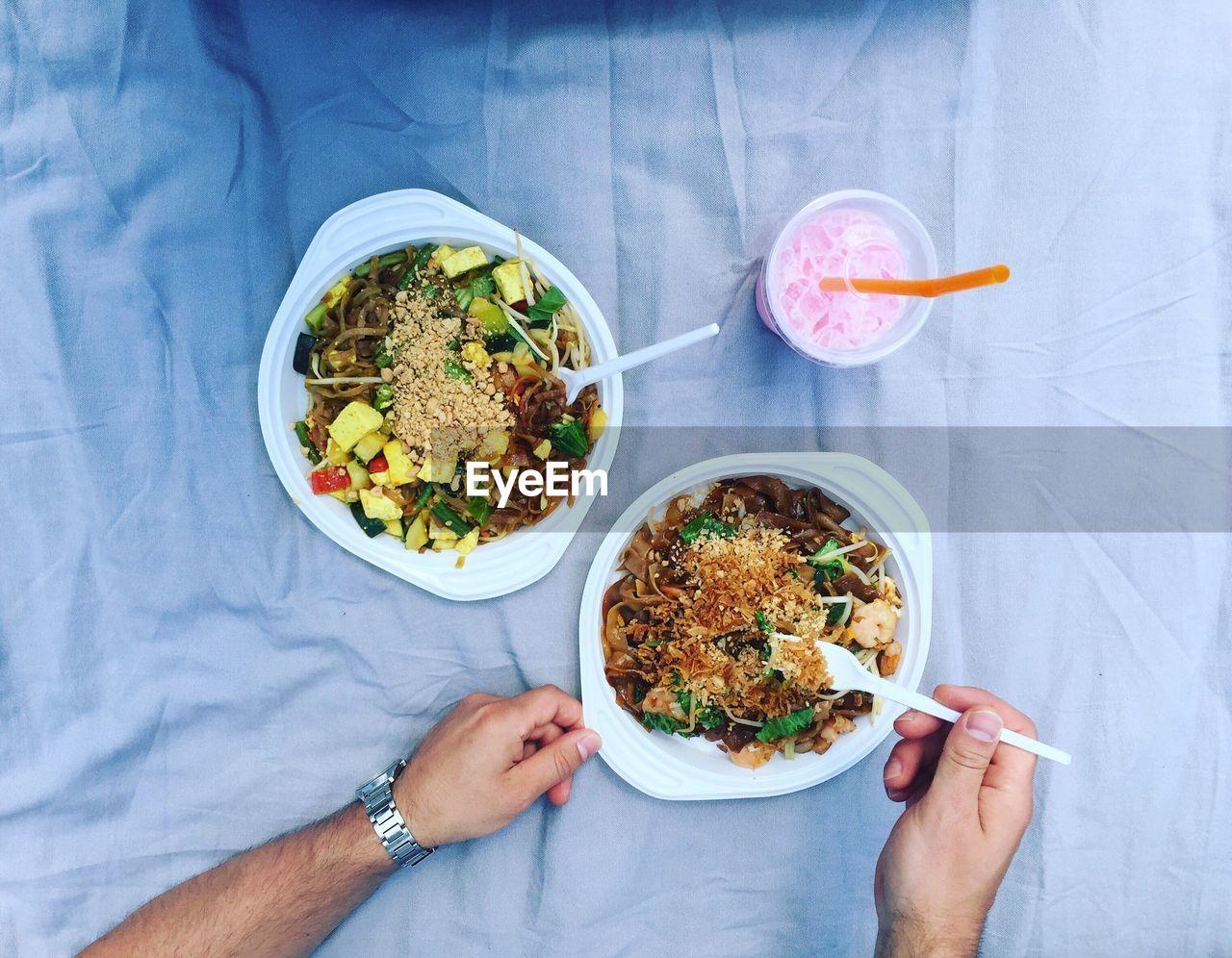 Cropped image of man eating food