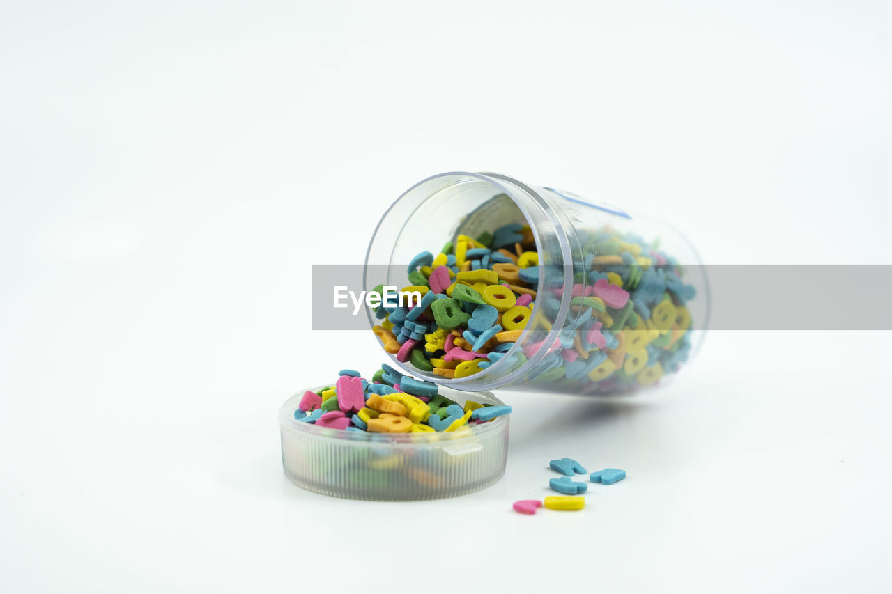 studio shot, white background, multi colored, still life, copy space, sweet food, indoors, pill, candy, sweet, container, large group of objects, food and drink, no people, food, close-up, dose, cut out, medicine, healthcare and medicine, temptation