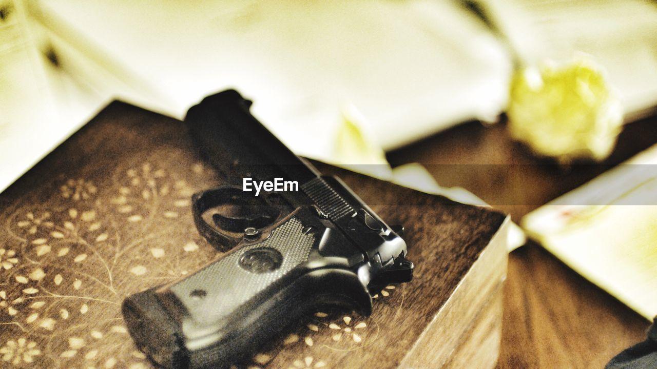 table, weapon, handgun, no people, gun, indoors, close-up, bullet, day