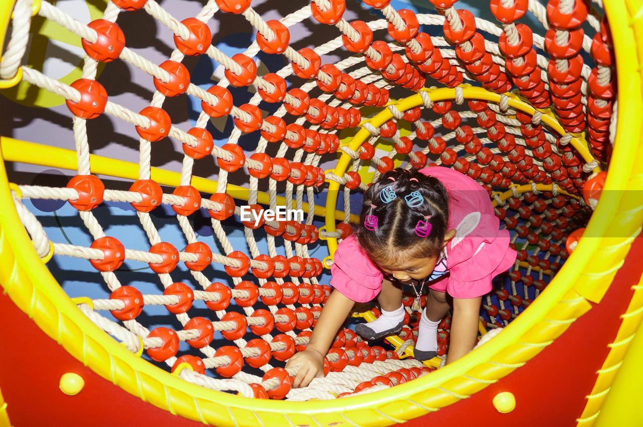 High Angle View Of Girl Playing At Playground