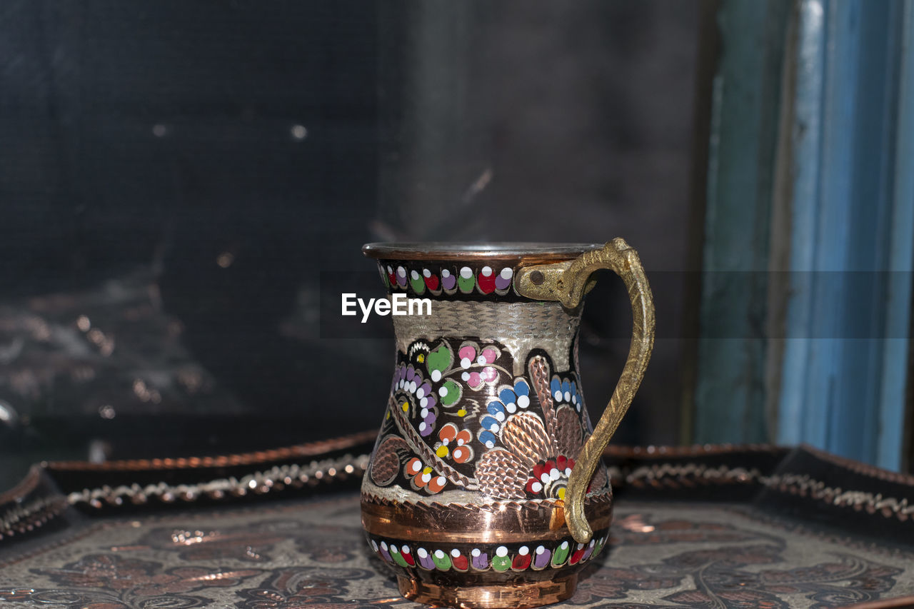 Close-up of antique container at market stall