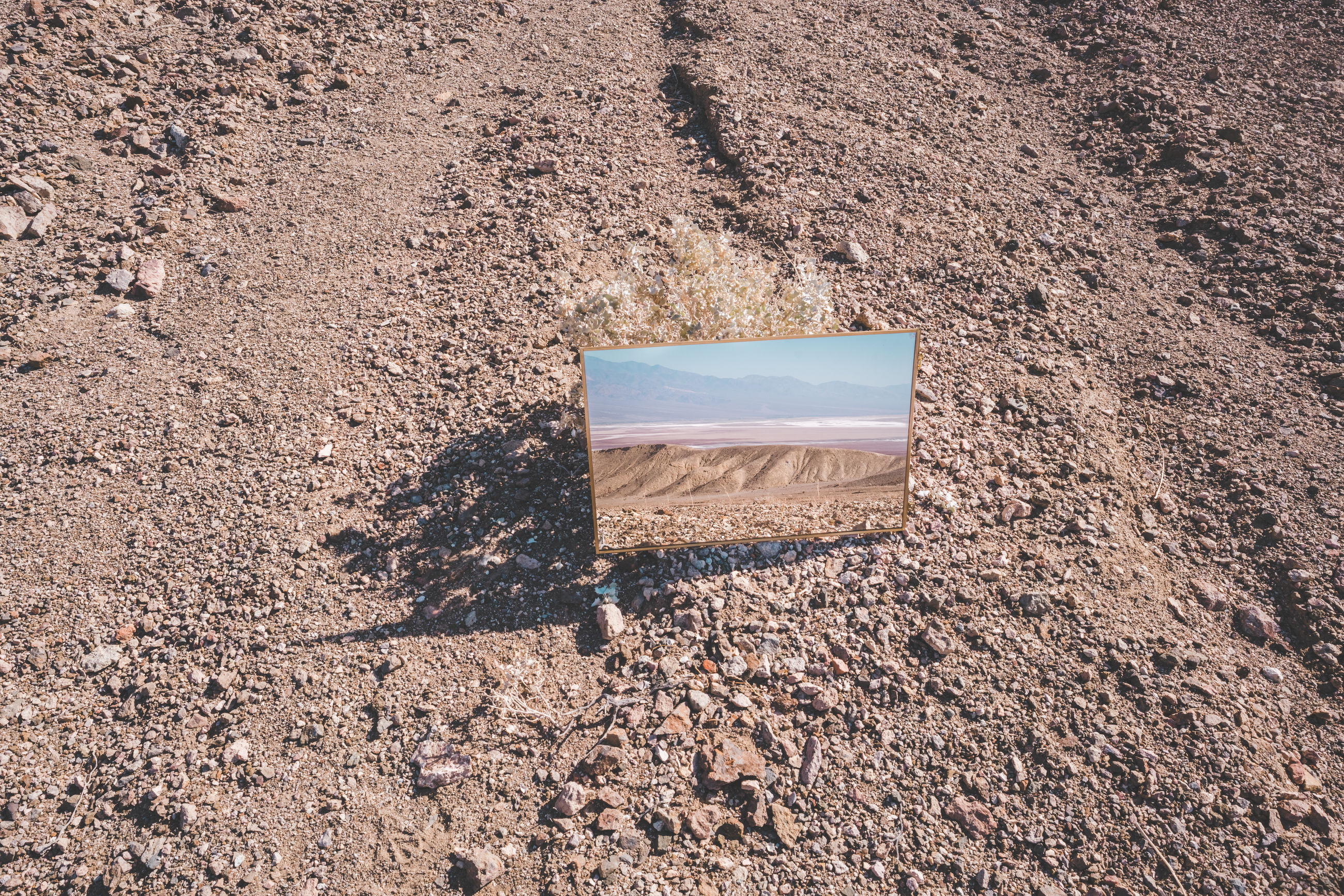 High angle view of mirror on sand