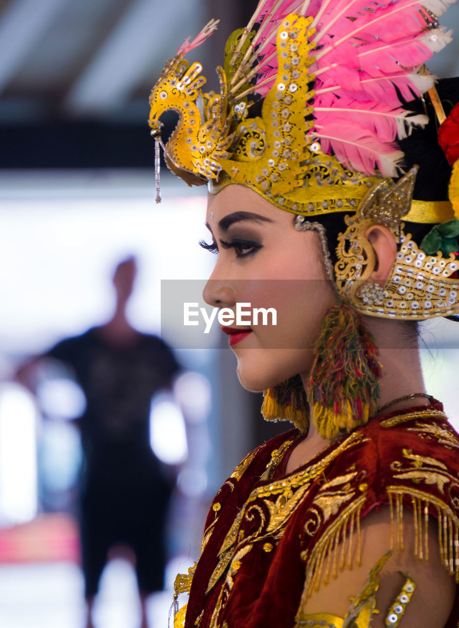 venetian mask, carnival - celebration event, real people, traditional clothing, arts culture and entertainment, costume, one person, headdress, celebration, focus on foreground, fashion, performance, lifestyles, young adult, indoors, young women, day, headwear, close-up, adult, people