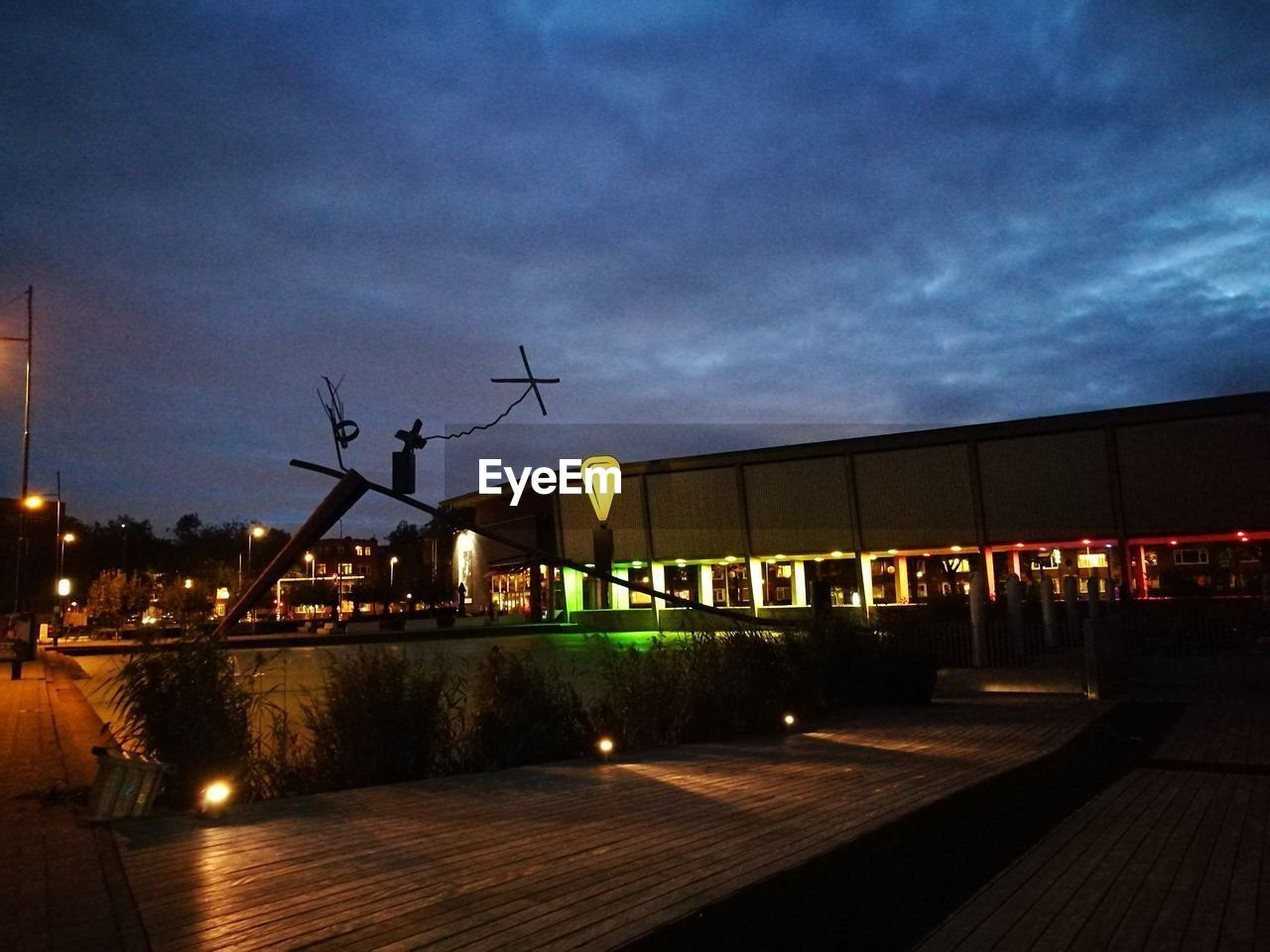 night, building exterior, architecture, built structure, illuminated, sky, outdoors, renewable energy, fuel and power generation, alternative energy, wind power, windmill, wind turbine, no people, cloud - sky, nature, city