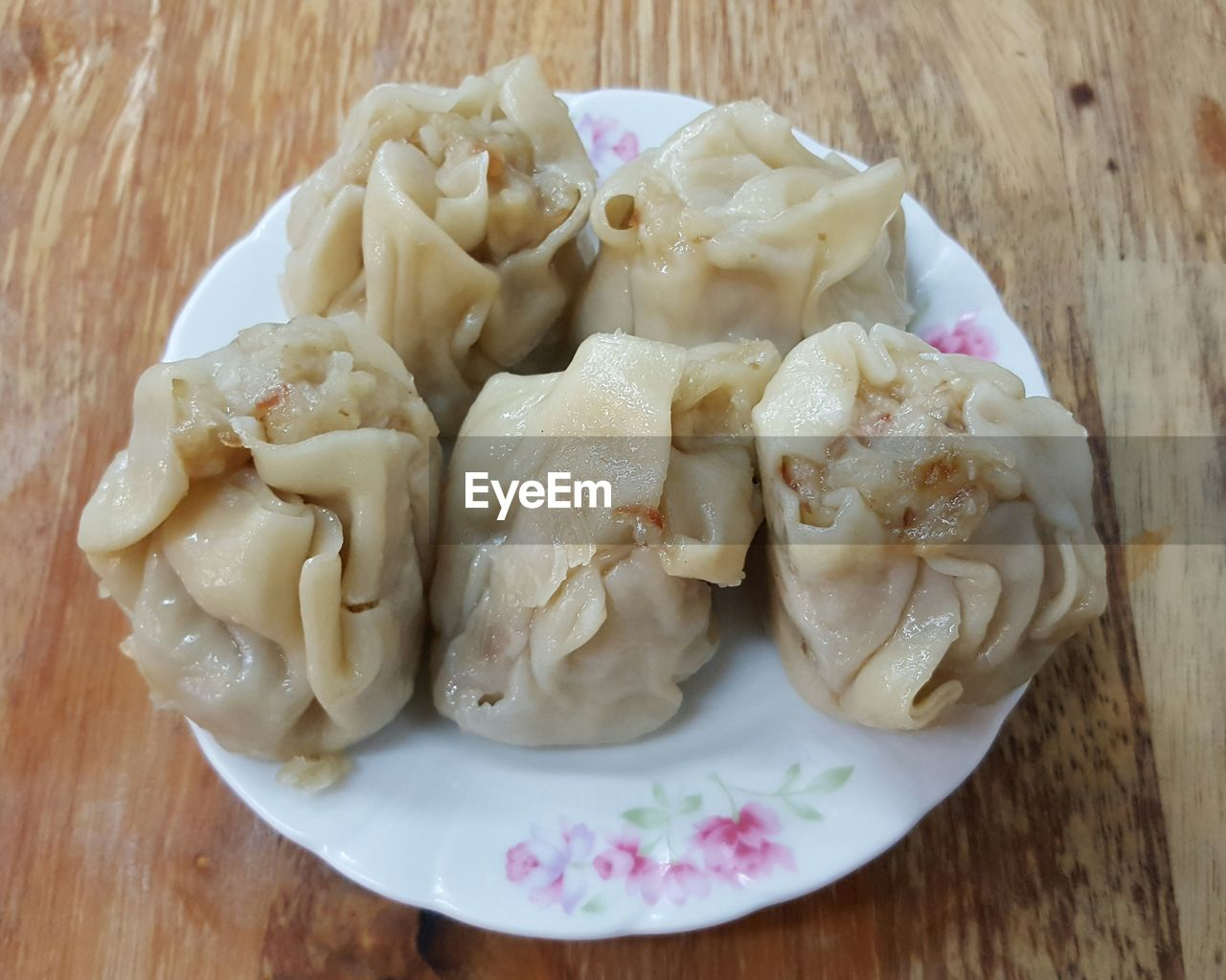 Close-Up Of Dumplings Served On Table