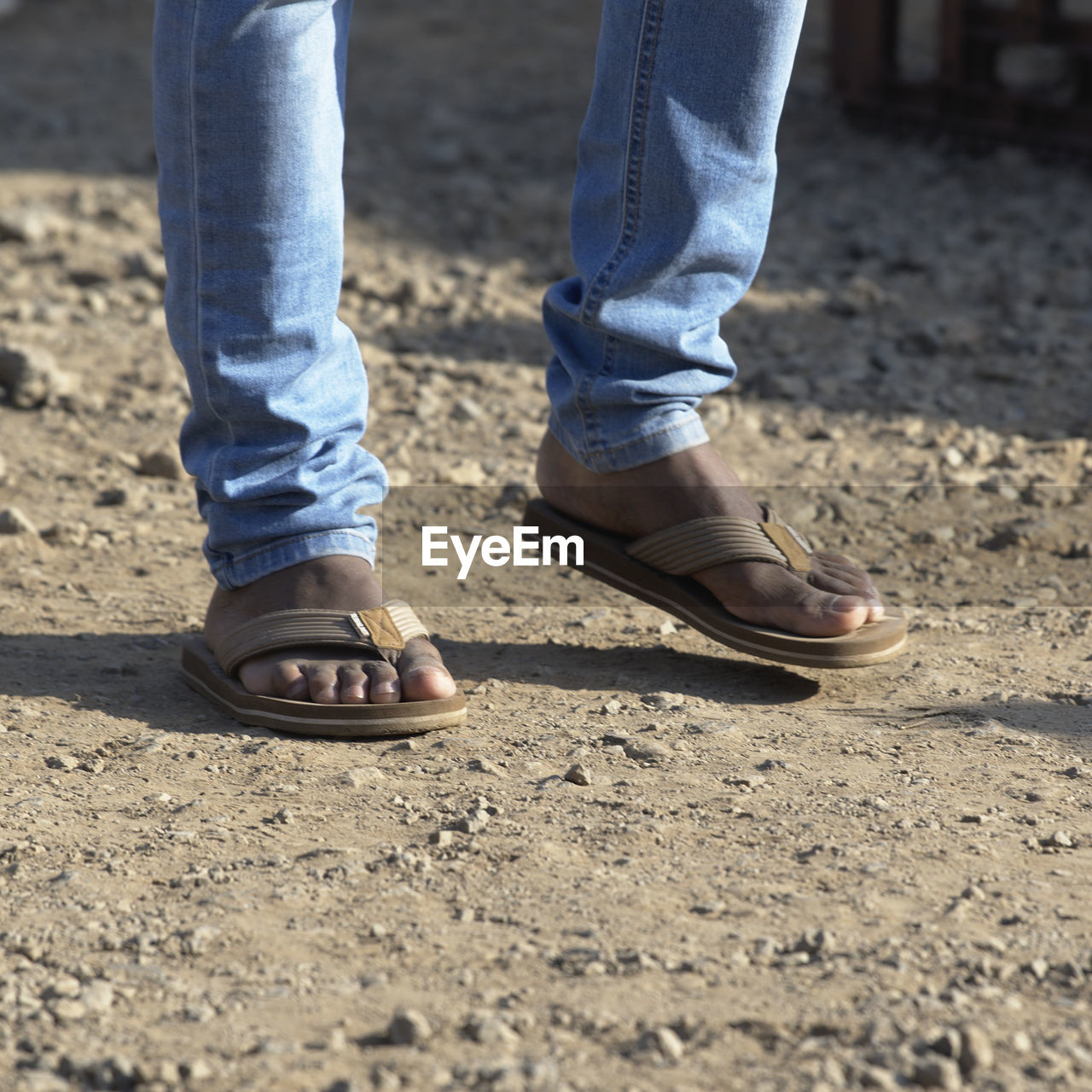 low section, human leg, body part, human body part, shoe, one person, jeans, real people, day, standing, casual clothing, human foot, lifestyles, outdoors, men, sunlight, leisure activity, nature, land, human limb
