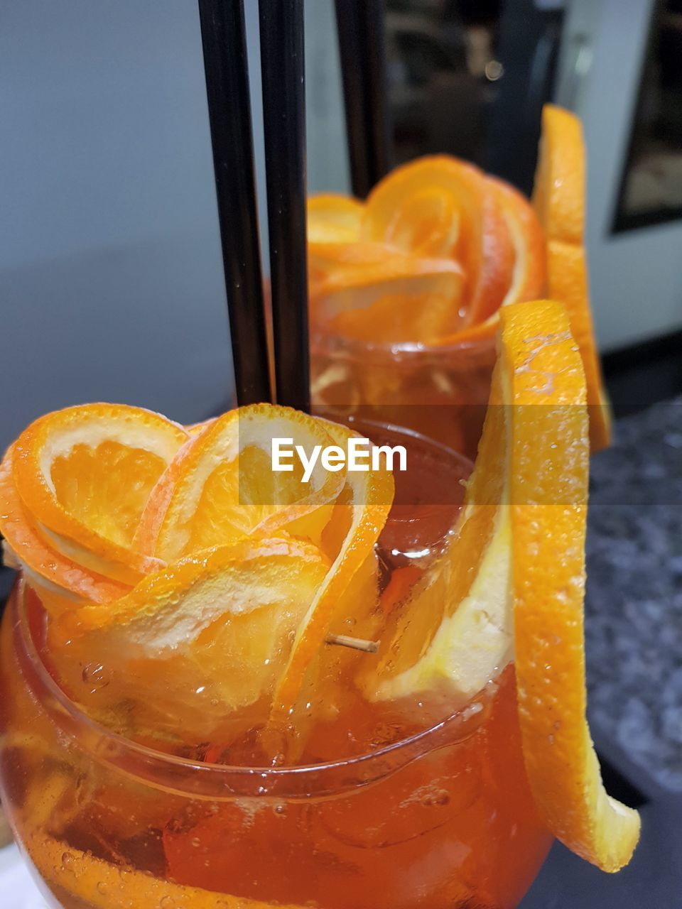 food and drink, orange - fruit, healthy eating, freshness, orange color, drinking glass, citrus fruit, slice, fruit, refreshment, food, no people, drink, drinking straw, close-up, indoors, day