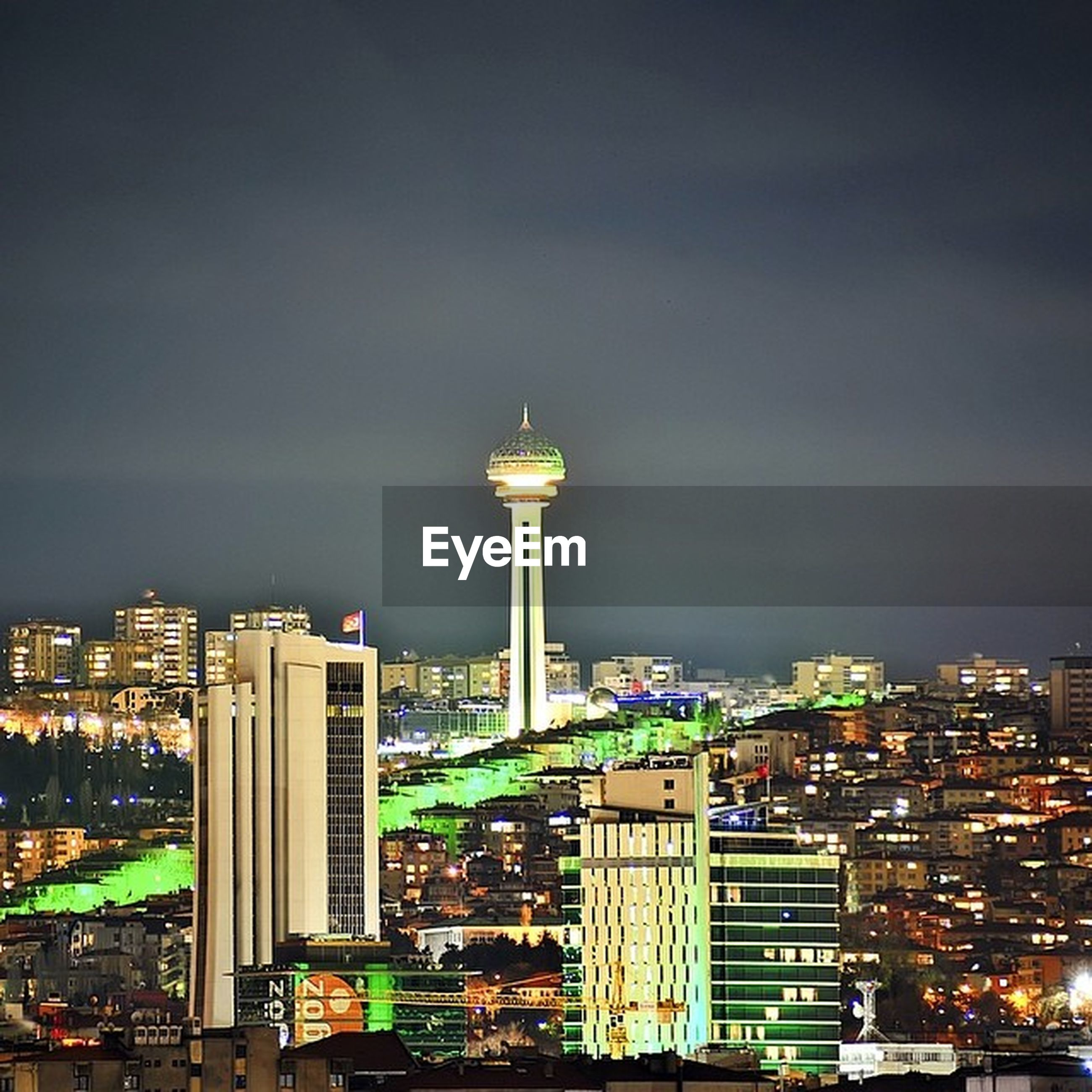 building exterior, architecture, built structure, city, illuminated, cityscape, tower, night, sky, tall - high, skyscraper, modern, capital cities, travel destinations, spire, communications tower, residential building, residential district, crowded, office building