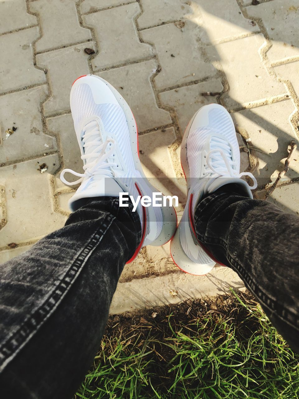 low section, shoe, human leg, real people, personal perspective, lifestyles, human body part, body part, high angle view, day, leisure activity, jeans, nature, land, unrecognizable person, men, outdoors, human foot