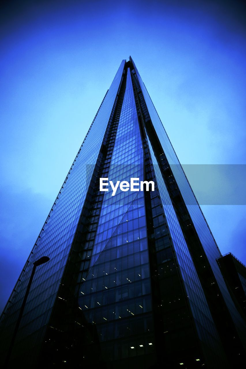 blue, low angle view, architecture, built structure, skyscraper, sky, modern, outdoors, no people, day, building exterior, city