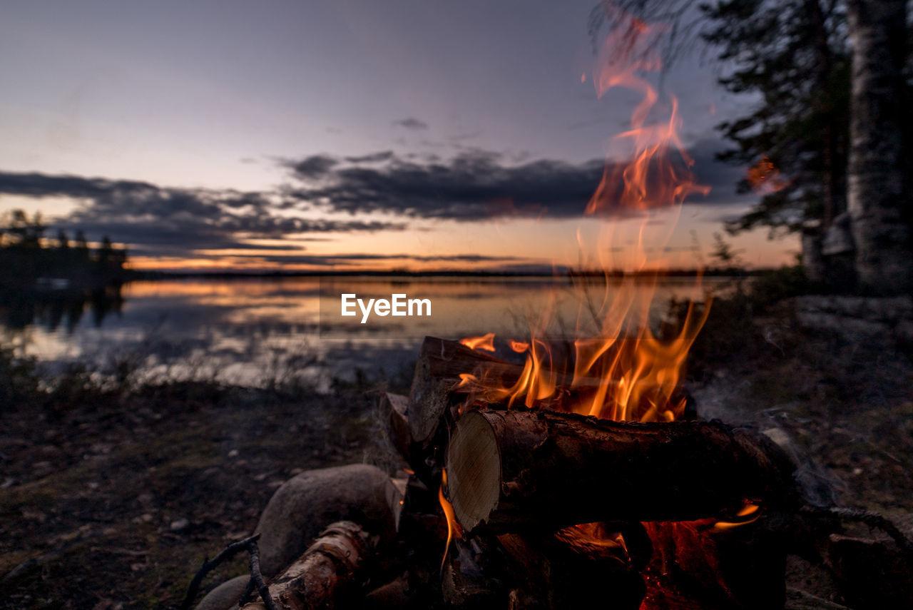 Bonfire At Lakeshore During Sunset
