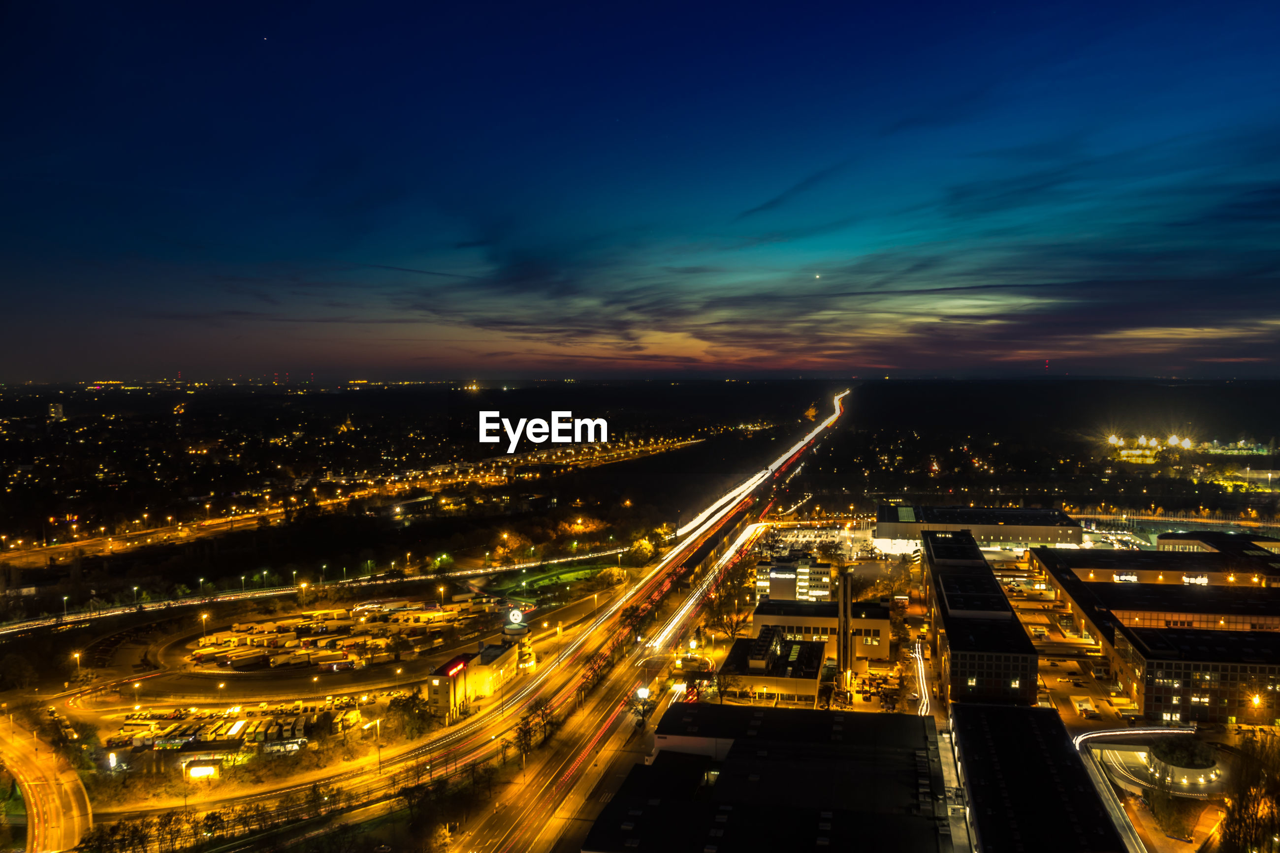 HIGH ANGLE VIEW OF LIGHT TRAILS ON HIGHWAY IN CITY