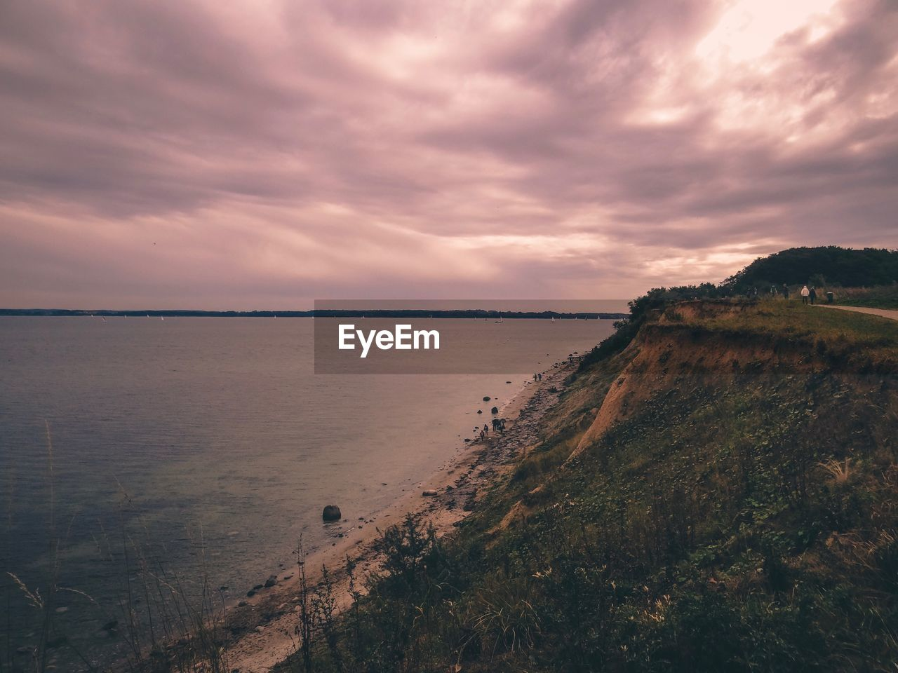 sky, cloud - sky, scenics - nature, water, tranquility, beauty in nature, sea, tranquil scene, nature, sunset, no people, land, beach, horizon, non-urban scene, outdoors, plant, environment