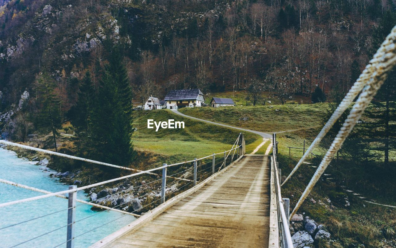 built structure, architecture, mountain, building exterior, day, transportation, tree, bridge - man made structure, no people, nature, outdoors, water, beauty in nature