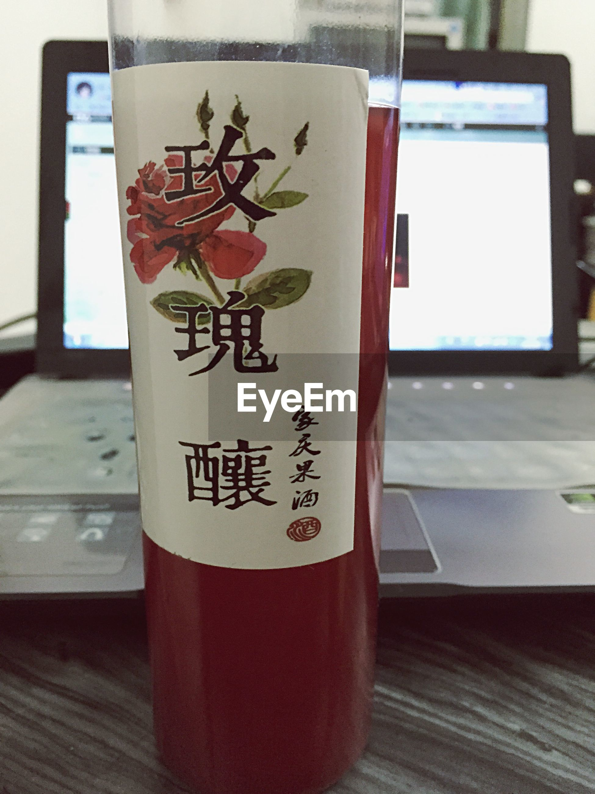 text, indoors, western script, table, communication, drink, still life, food and drink, close-up, freshness, refreshment, wood - material, glass - material, focus on foreground, no people, paper, message, handwriting, drinking glass, book
