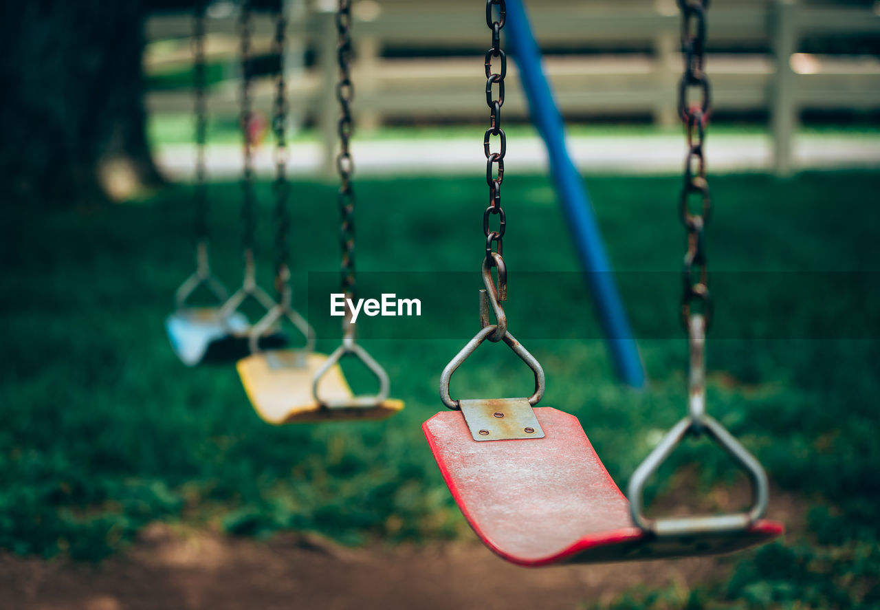 Close-up of swings in playground