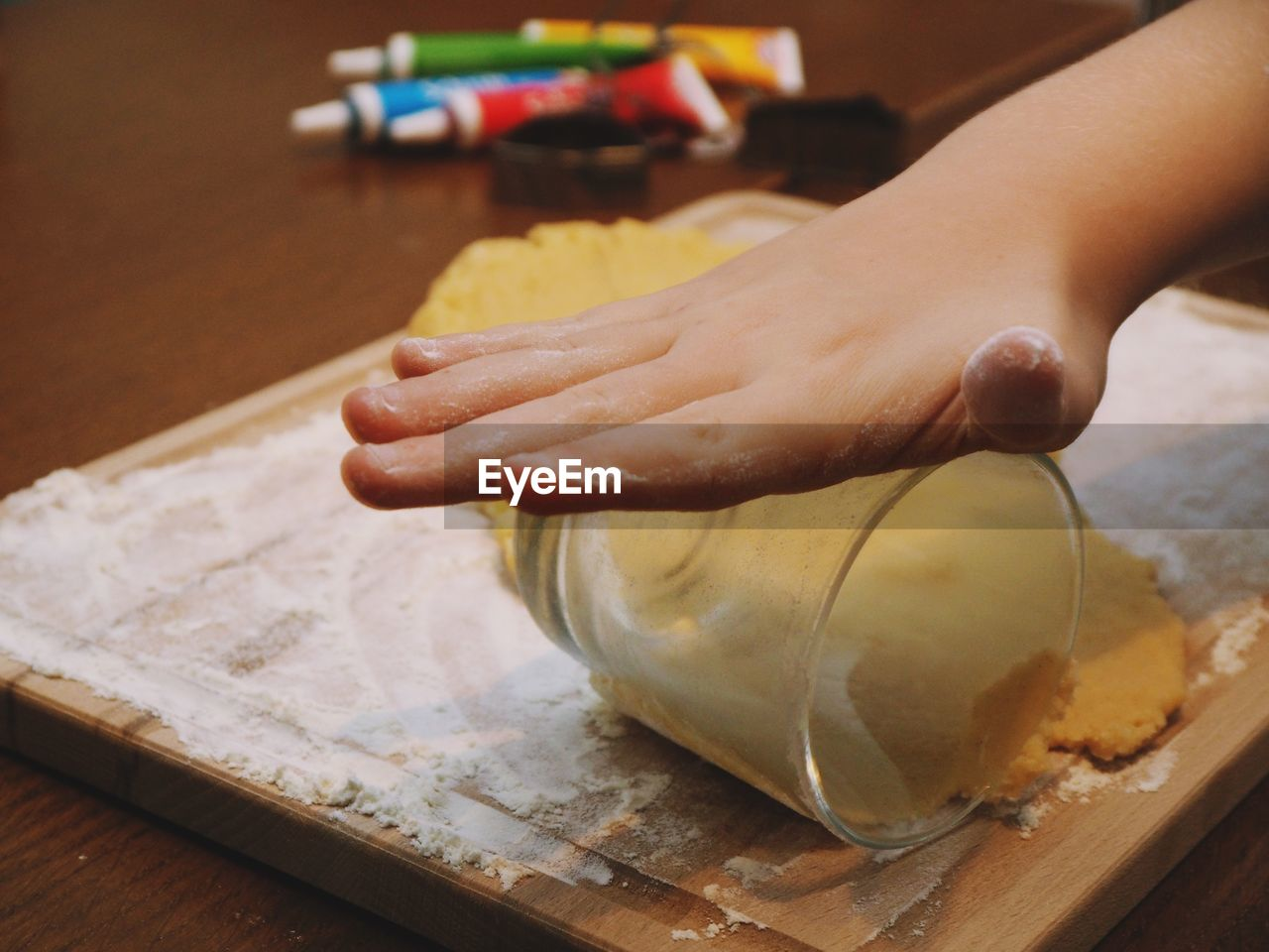 human hand, human body part, hand, real people, one person, food, preparation, table, food and drink, indoors, unrecognizable person, dough, close-up, freshness, cutting board, lifestyles, preparing food, wood - material, holding, finger, kneading, human limb