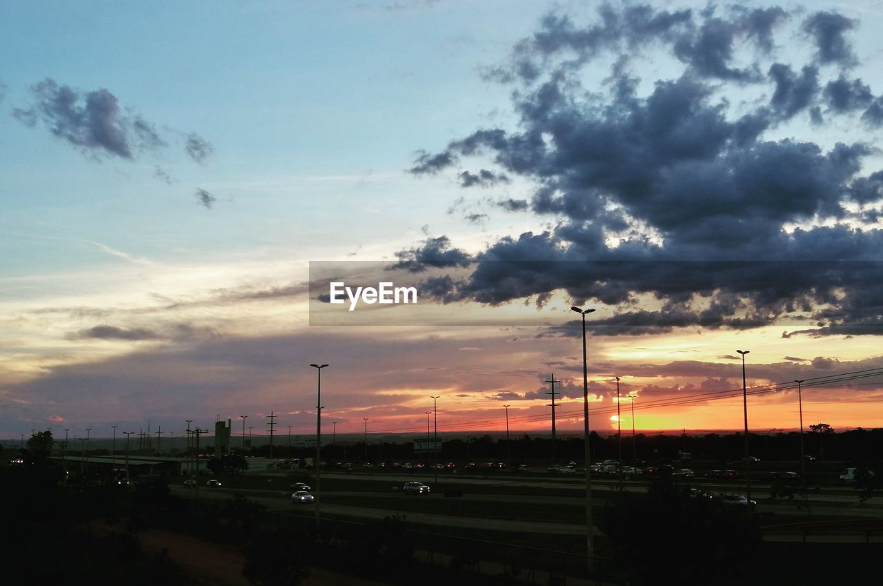 cloud - sky, sky, sunset, nature, no people, transportation, beauty in nature, mode of transportation, outdoors, electricity, built structure, architecture, car, orange color, connection, motor vehicle, cable, land vehicle, technology, scenics - nature