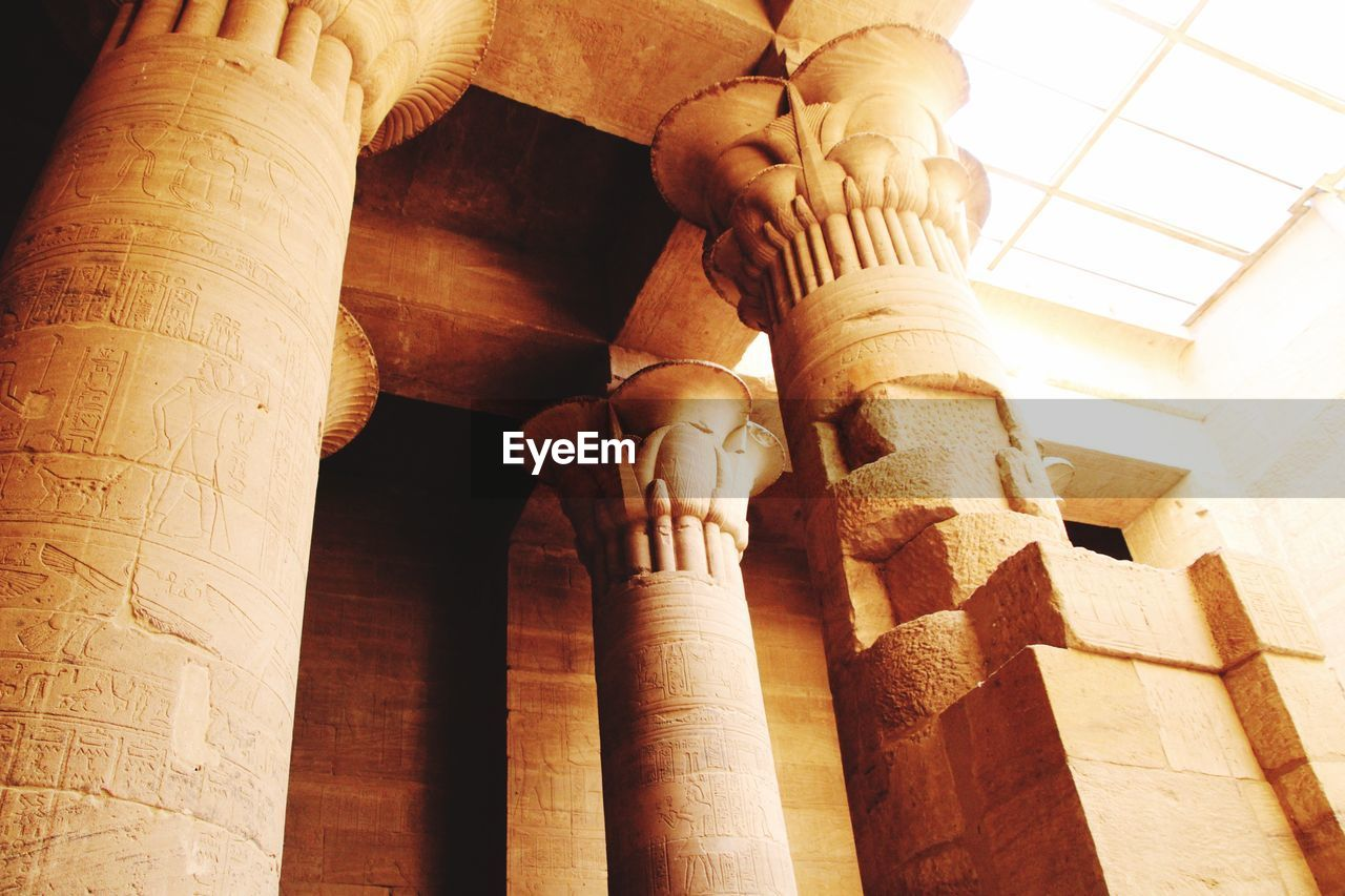 architecture, architectural column, the past, low angle view, history, built structure, art and craft, travel destinations, ancient, craft, creativity, tourism, travel, indoors, no people, carving - craft product, sculpture, building, day, ceiling, ancient civilization