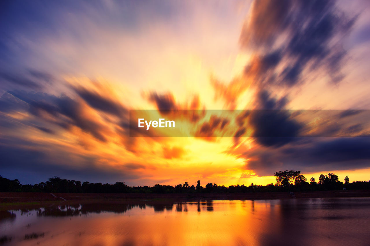 sunset, sky, cloud - sky, water, scenics - nature, beauty in nature, orange color, reflection, lake, tranquility, tranquil scene, nature, no people, dramatic sky, idyllic, silhouette, waterfront, non-urban scene, tree, outdoors, romantic sky