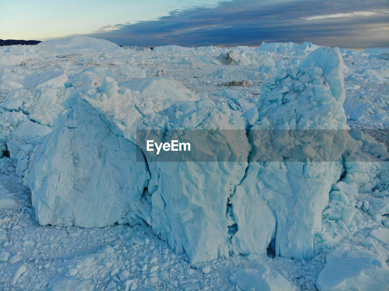 scenics - nature, cold temperature, beauty in nature, tranquil scene, ice, glacier, tranquility, environment, landscape, winter, snow, nature, day, sky, idyllic, no people, frozen, remote, white color, iceberg