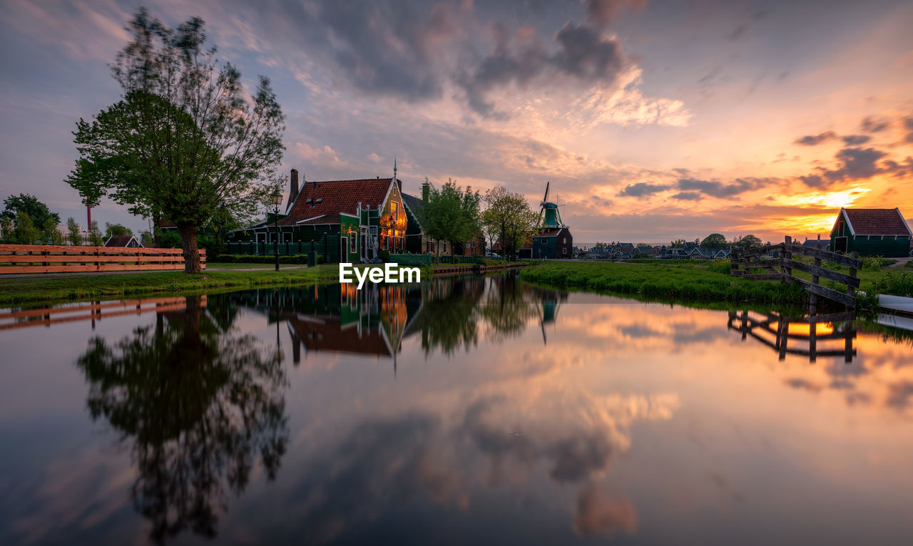 sky, water, cloud - sky, built structure, architecture, reflection, building exterior, plant, lake, tree, nature, waterfront, sunset, beauty in nature, belief, building, no people, scenics - nature, religion, outdoors