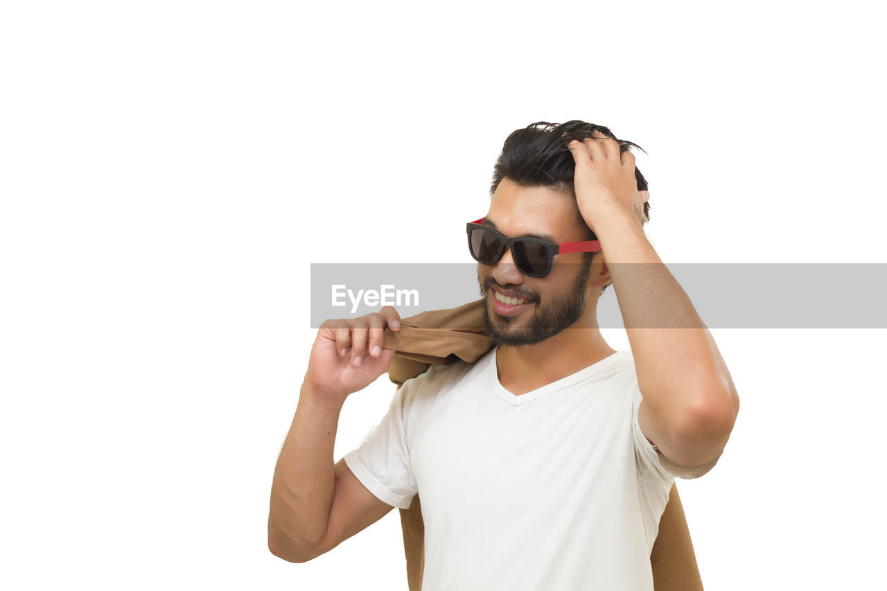 sunglasses, studio shot, young men, white background, fashion, waist up, young adult, front view, casual clothing, glasses, lifestyles, one person, copy space, indoors, cut out, standing, portrait, leisure activity