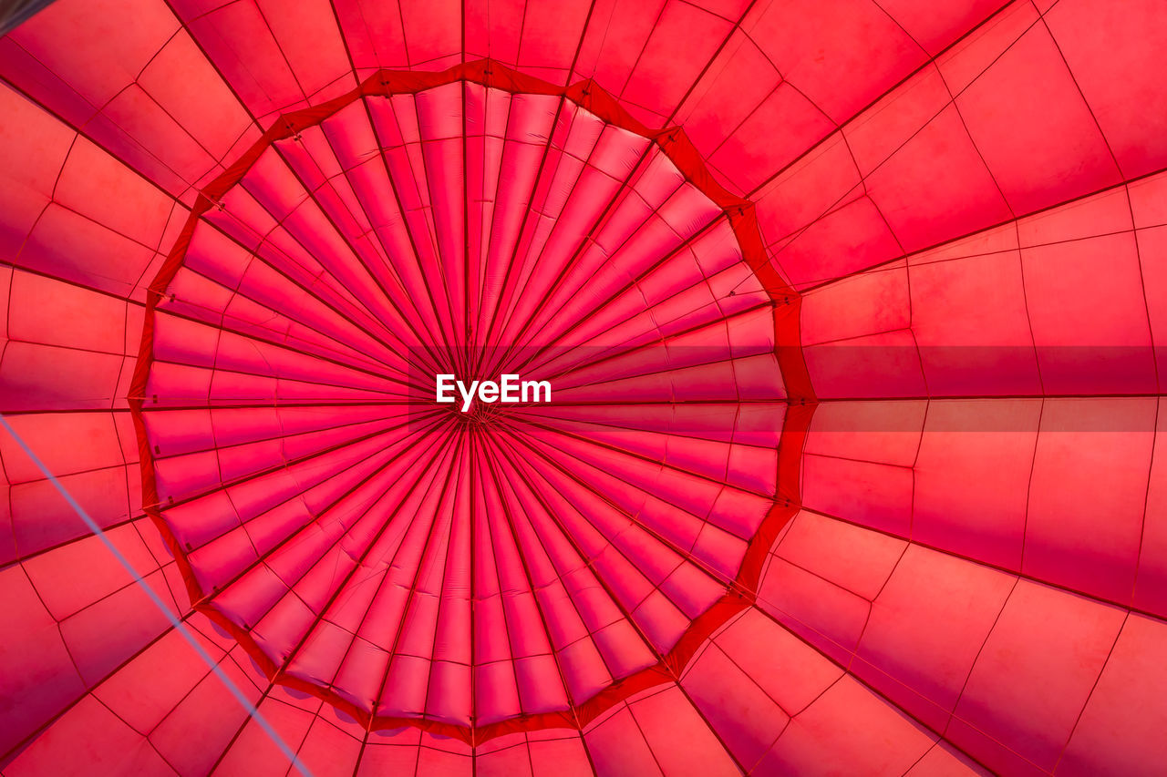 pattern, full frame, backgrounds, red, low angle view, no people, balloon, geometric shape, hot air balloon, shape, design, pink color, air vehicle, directly below, art and craft, outdoors, day, multi colored, textured, architecture, ceiling