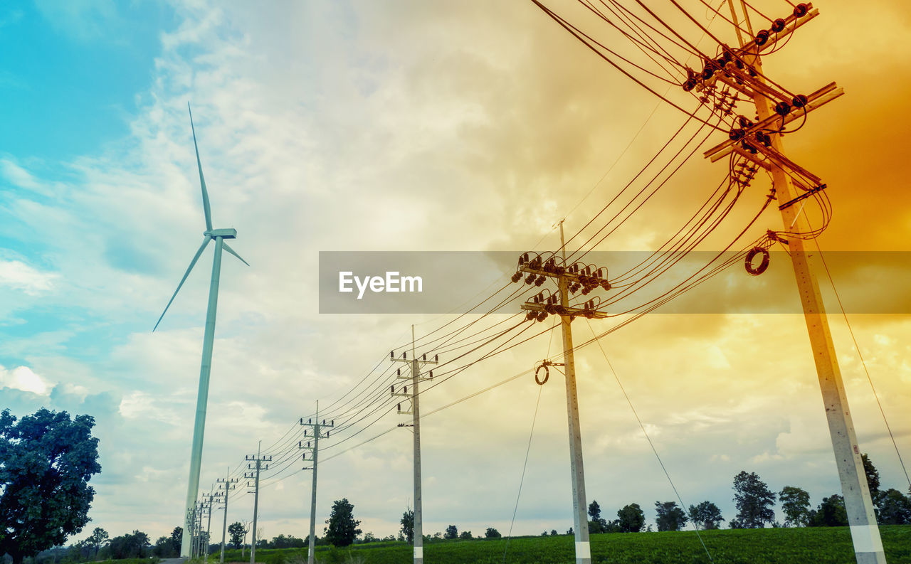 sky, cloud - sky, low angle view, fuel and power generation, electricity, electricity pylon, cable, power line, nature, technology, power supply, no people, connection, environmental conservation, day, plant, outdoors, environment, renewable energy, alternative energy