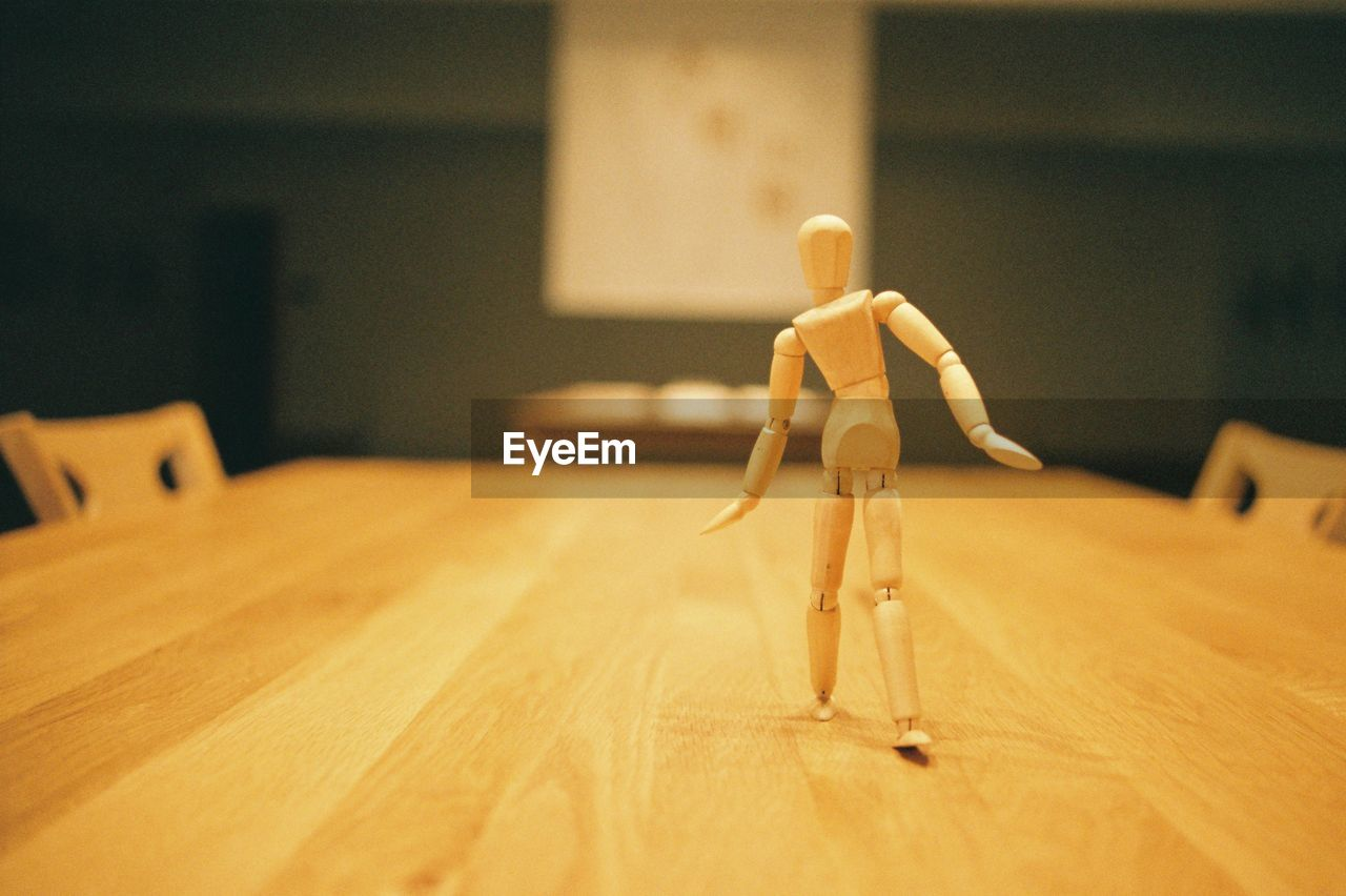 Wooden Figurine On Table At Homer