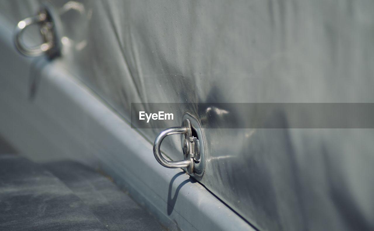 Close-up of metallic part on vehicle