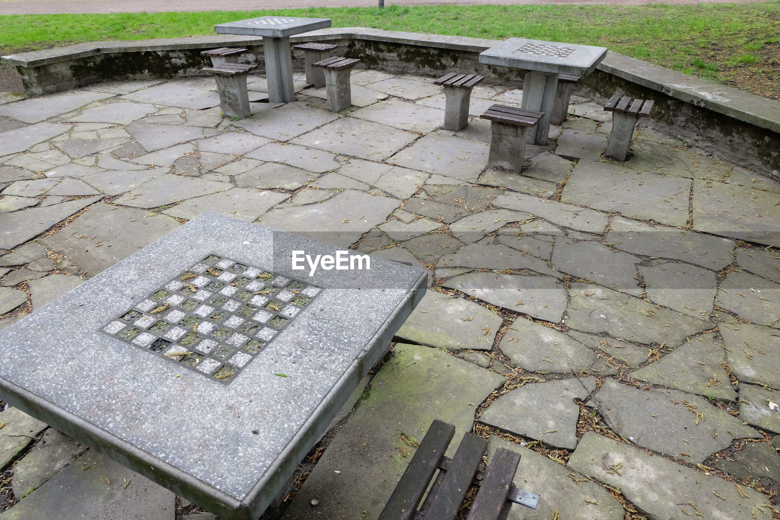 Stone chess board and seats at park