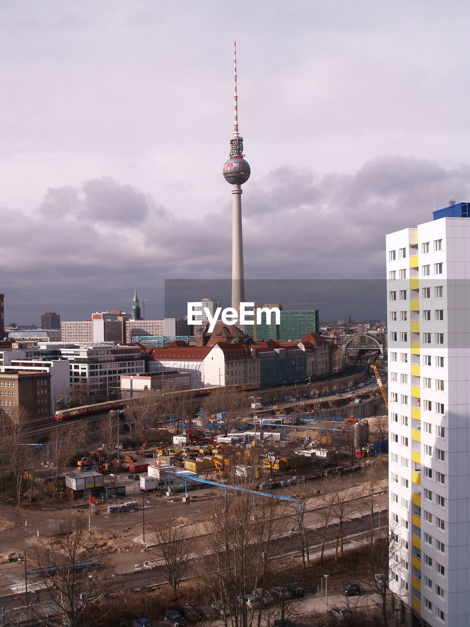 Fernsehturm and city against sky