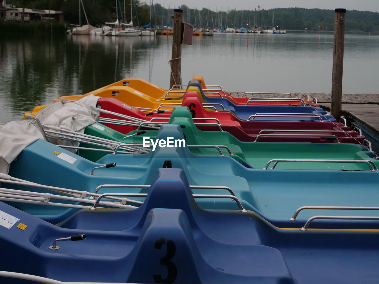 nautical vessel, transportation, water, mode of transportation, moored, no people, nature, day, in a row, lake, outdoors, side by side, absence, pedal boat, kayak, architecture, pier, high angle view